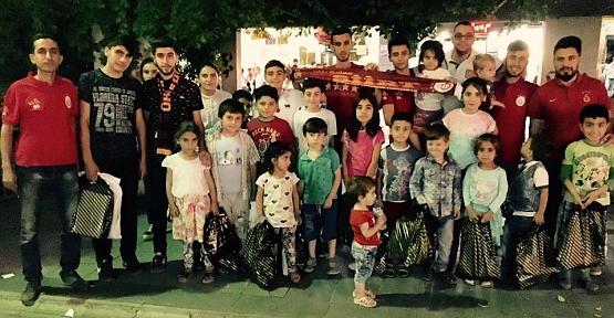 Siirt UltrAslan Taraftar Grubundan Yetim Çocuklara Giysi Yardımı