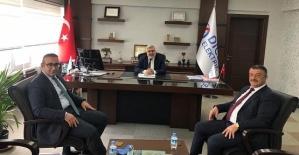 Kaymakam Hasar ve Başkan Cellek, Dicle Elektrik Bölge Müdürü Arvas'ı Ziyaret Etti